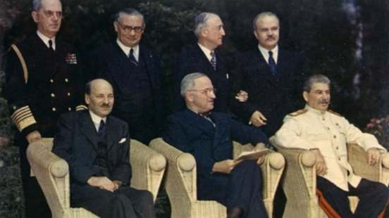 clement-attlee-harry-truman-and-joseph-stalin-seated-outdoors-at-potsdam-conference-1945